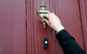 Hand Knocking on Door